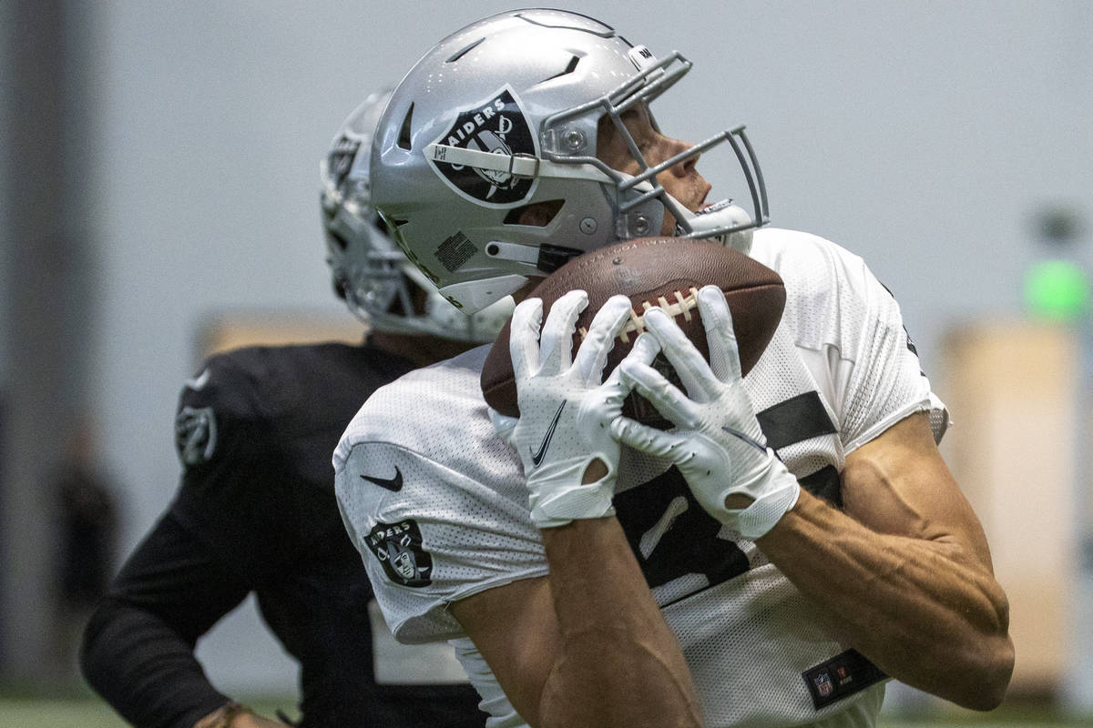 Raiders tight end Derek Carrier (85) secures a catch during practice at the Intermountain Healt ...