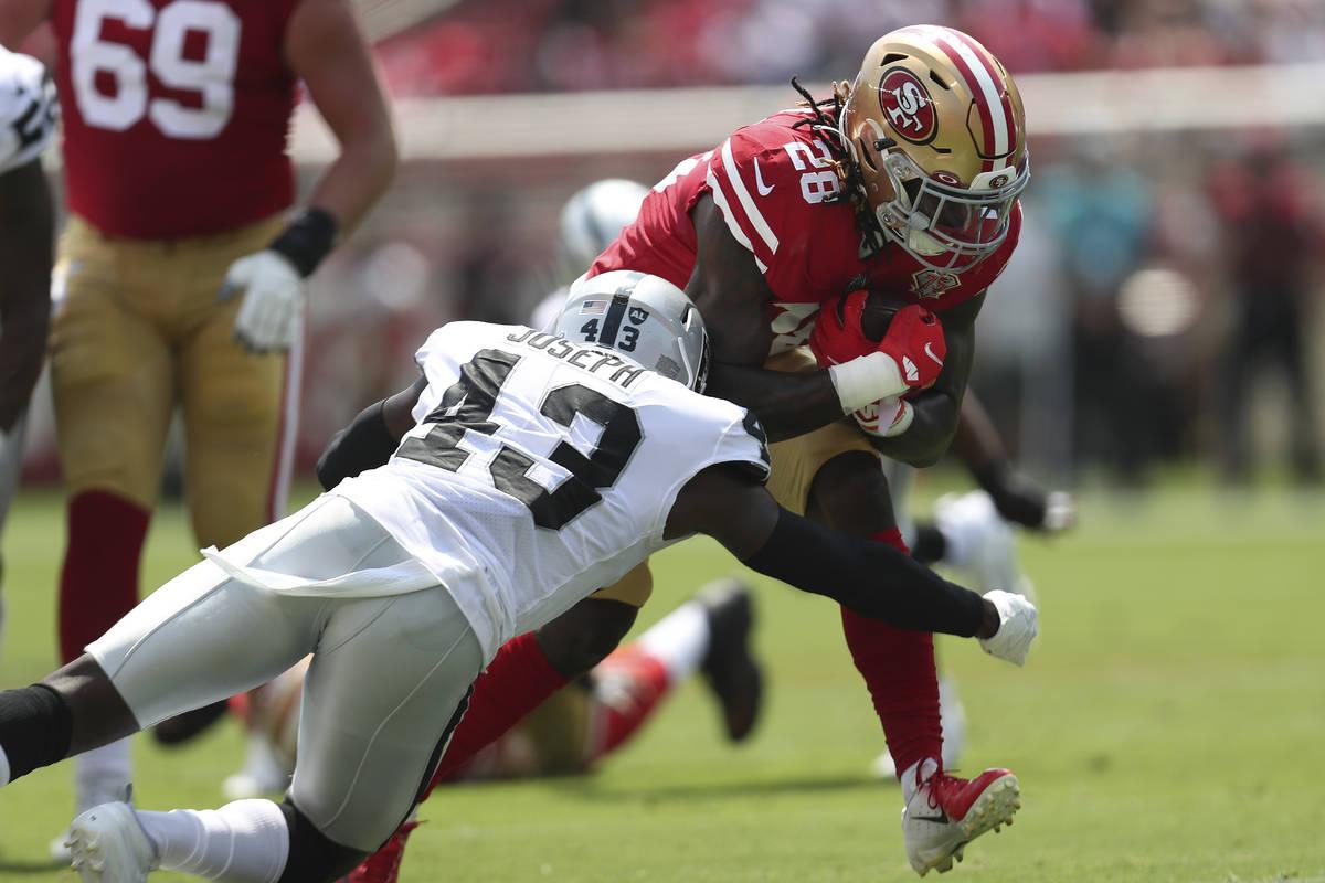 San Francisco 49ers running back Trey Sermon (28) runs against Las Vegas Raiders free safety Ka ...