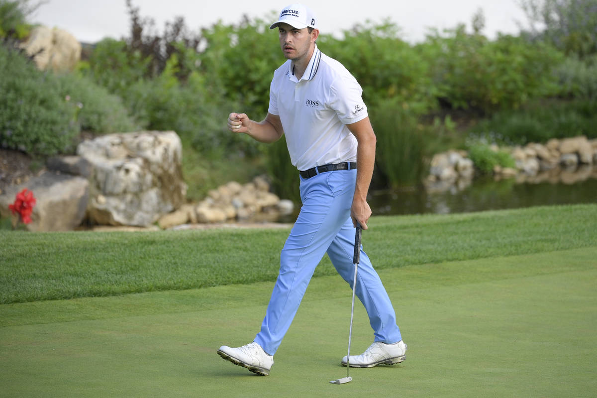 Patrick Cantlay reacts after sinking his putt on the 128th green during the final round of the ...