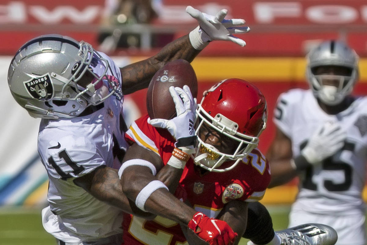 Raiders wide receiver Henry Ruggs III (11) pulls in an acrobatic catch over Kansas City Chiefs ...