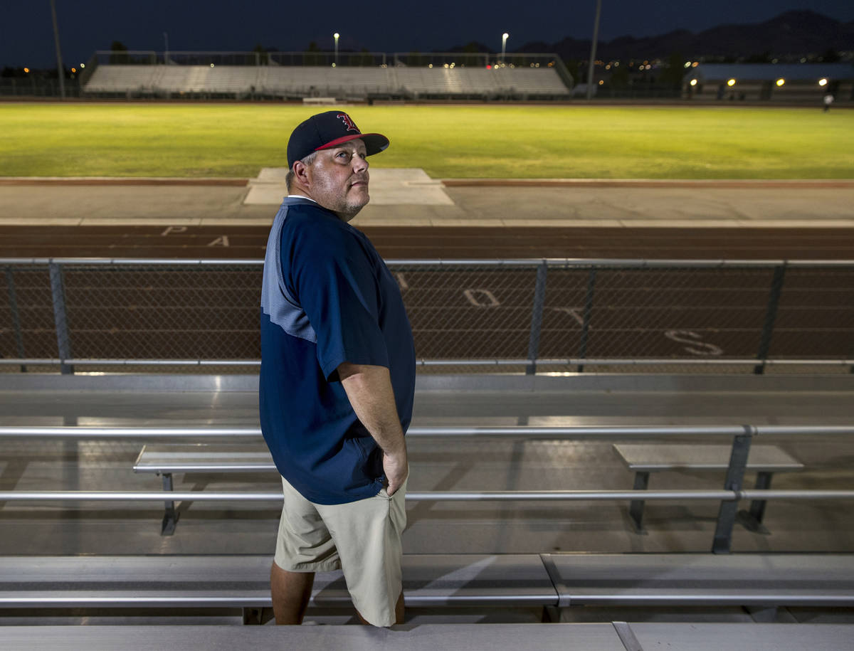 Liberty High School football coach Rich Muraco in the stands on the empty football field on Thu ...