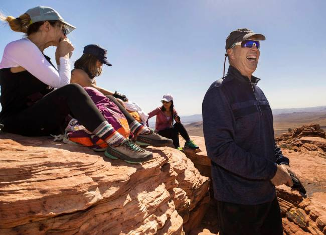 52 Peaks founder/leader Branch Whitney, right, shares a laugh with fellow hikers at the top of ...