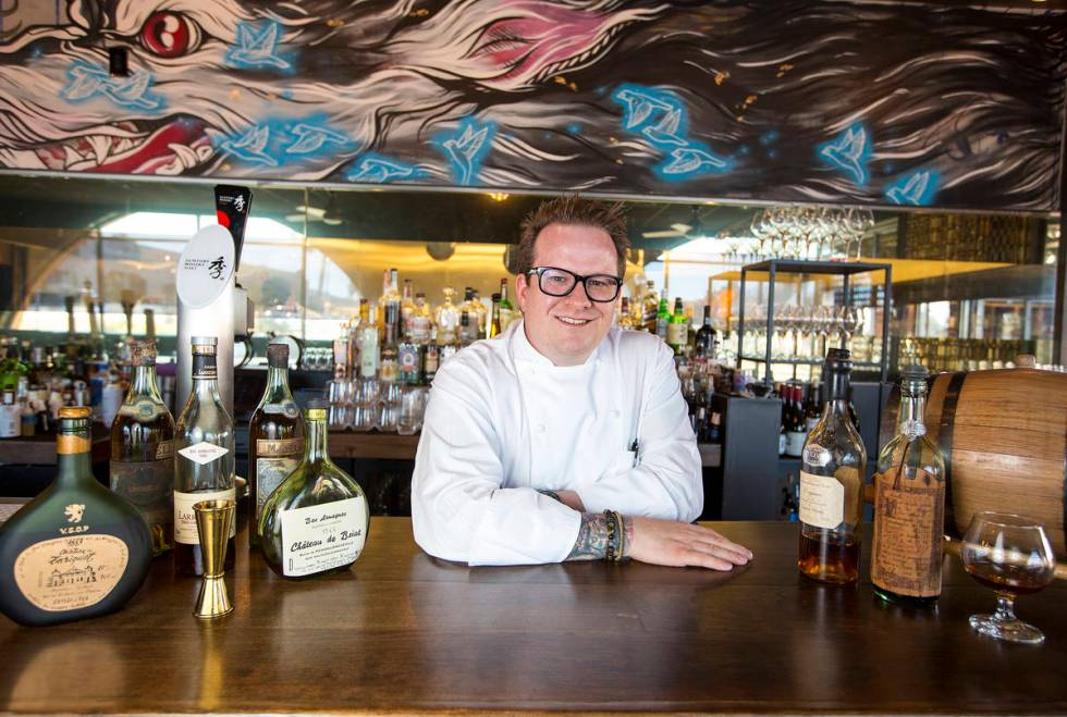 Brian Howard, chef and owner of Sparrow and Wolf, poses with his extremely rare spirits at his ...