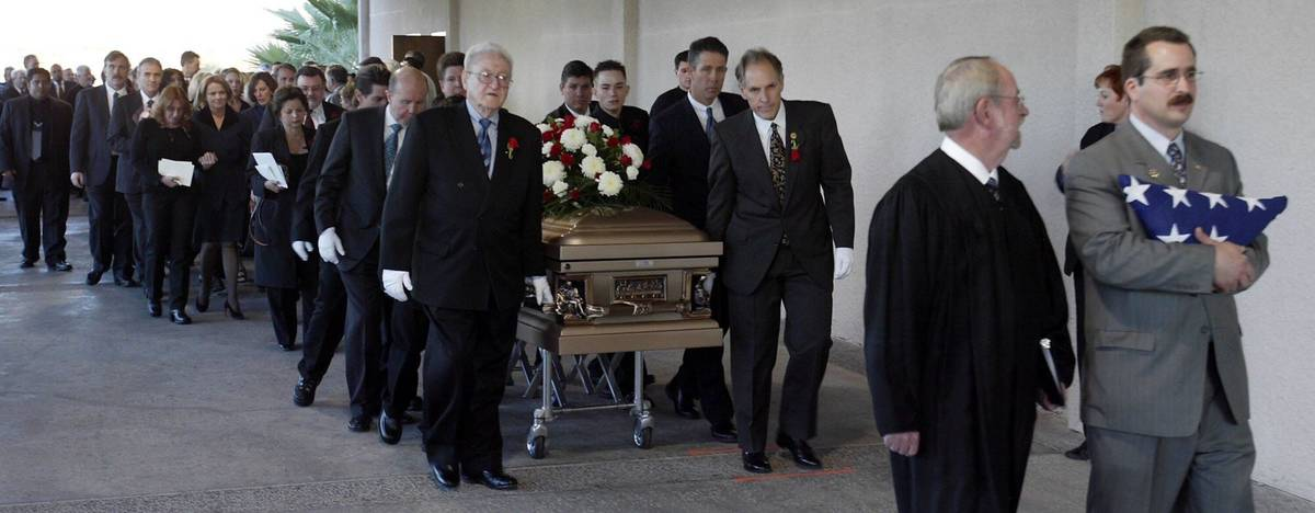 Attorney Richard Wright, right, and George Foley Sr., left, lead as they carry the casket of fo ...