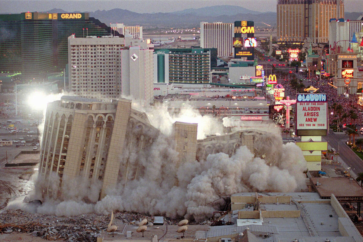 The Aladdin Hotel & Casino comes tumbling down as it is imploded, Monday night, April 27, 1998, ...