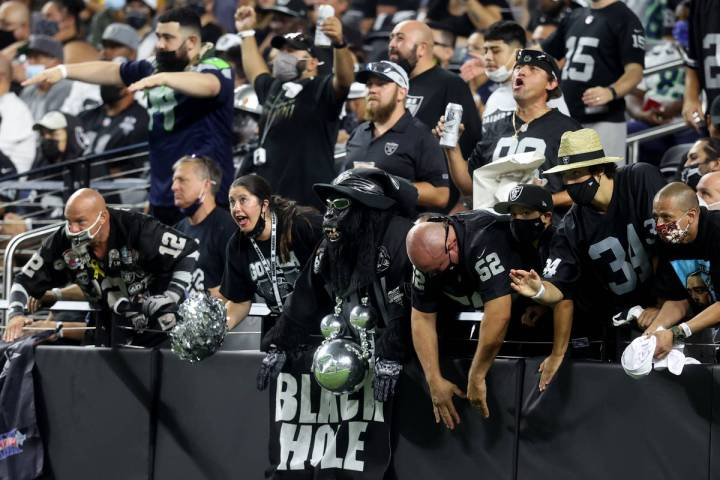 Fans in the Black Hole cheer during the third quarter of the Raiders home opening pre-season NF ...