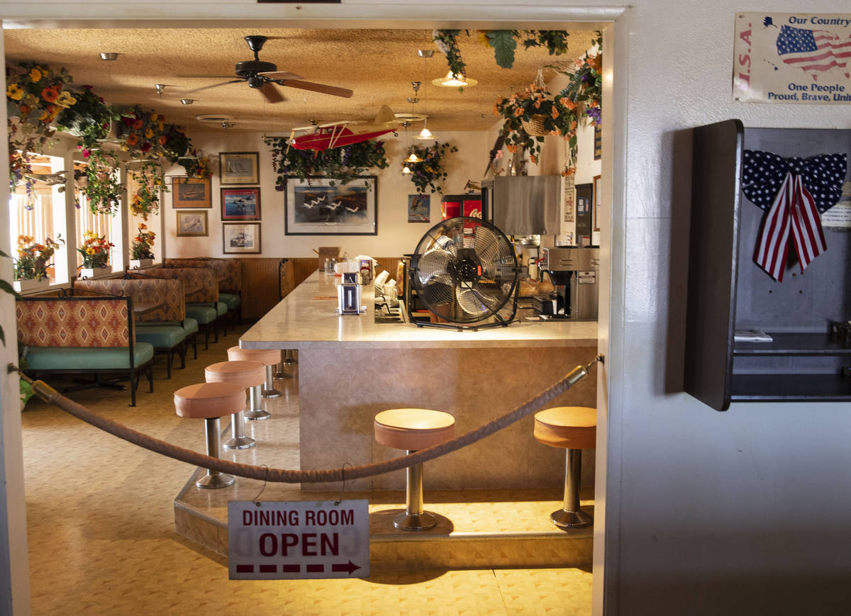 A dinning room and and a phone booth are seen inside Cal-Nev-Ari restaurant-casino, on Thursday ...