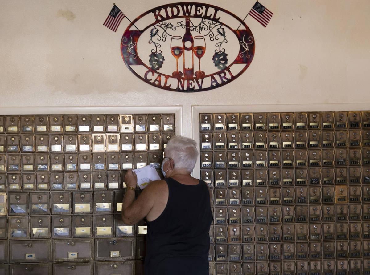 John Davis gets his mail from a communal mailbox inside Cal-Nev-Ari restaurant-casino, on Thurs ...