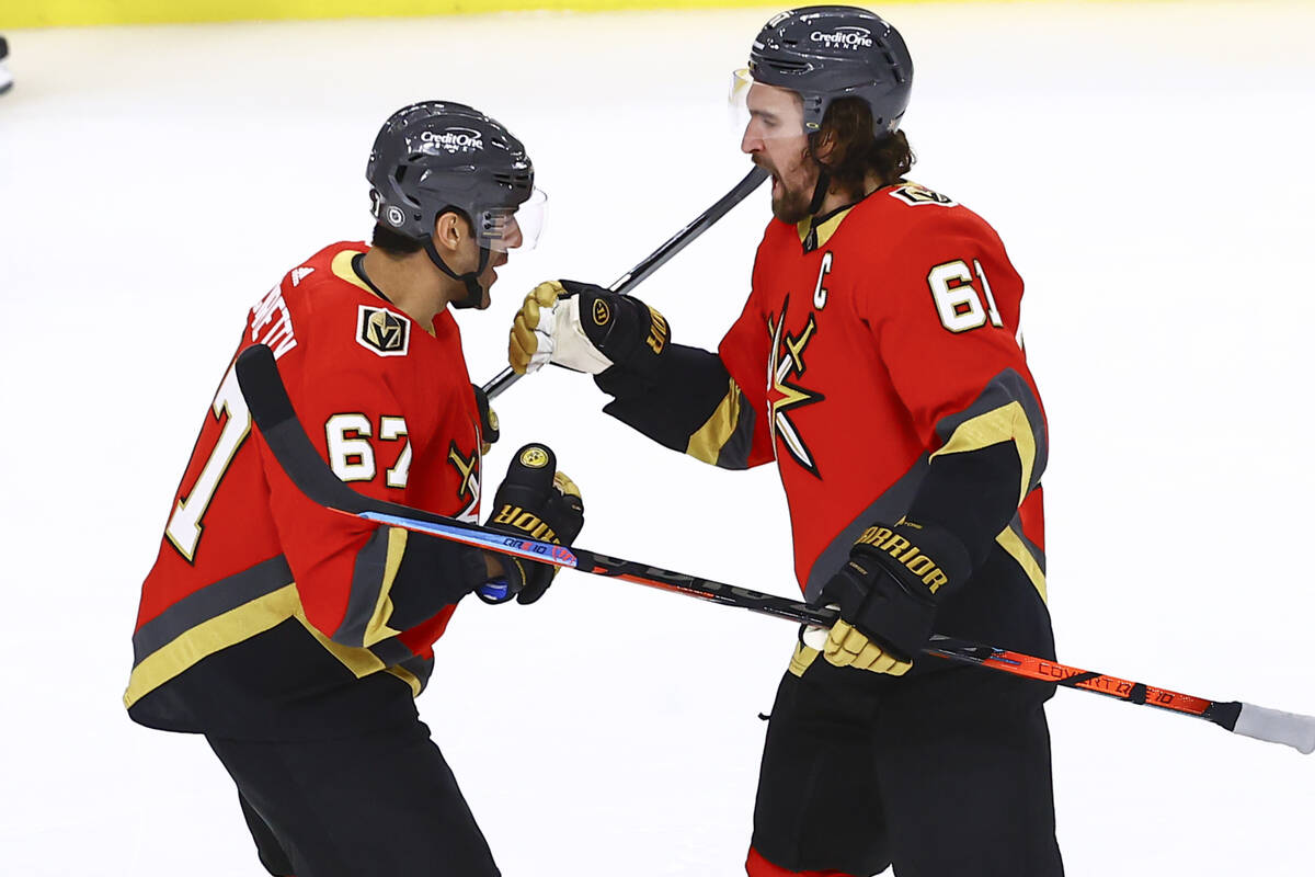 Golden Knights' Mark Stone, right, celebrates his goal with Max Pacioretty during the third per ...