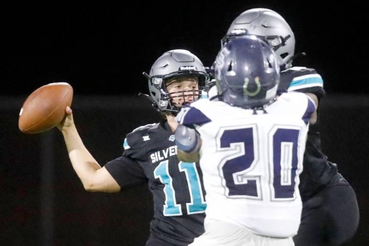 Silverado High School quarterback Brandon Tunnell (11) throws a pass during the second half of ...