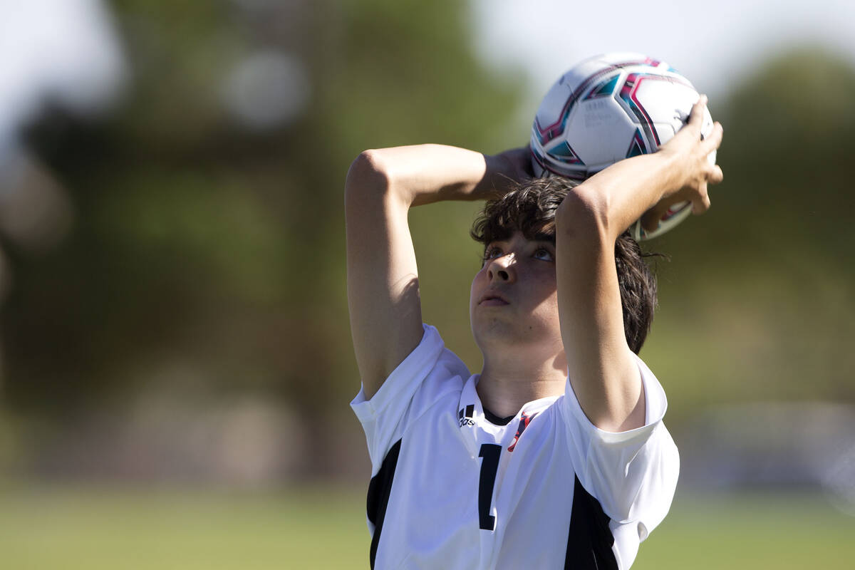 Liberty's Kristopher Cordero (1) throws in during a high school soccer game against Liberty at ...
