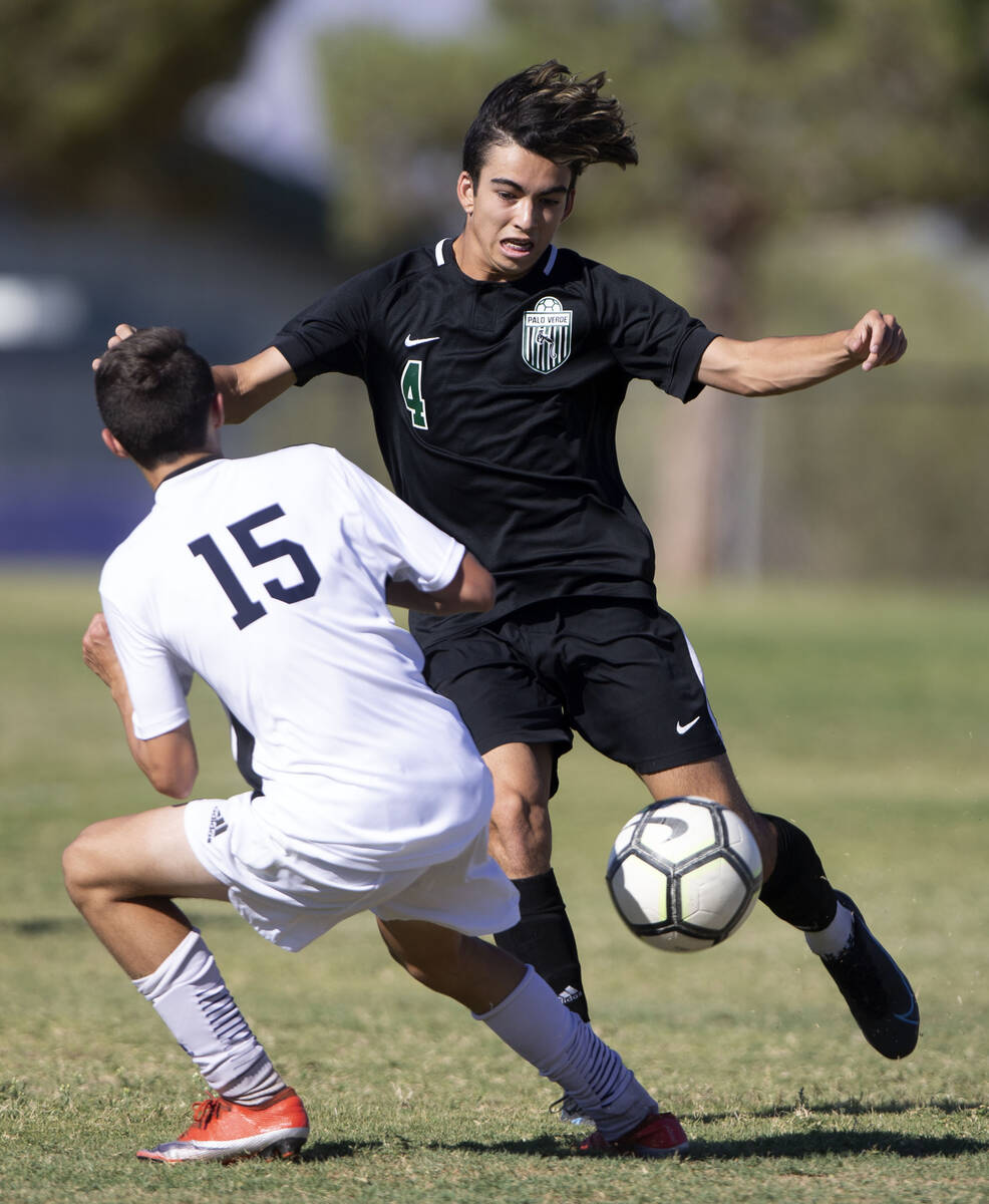 Liberty's Anthony Angotti (15) falls behind as Palo Verde's Gannon Gaudioso (4) passes during t ...