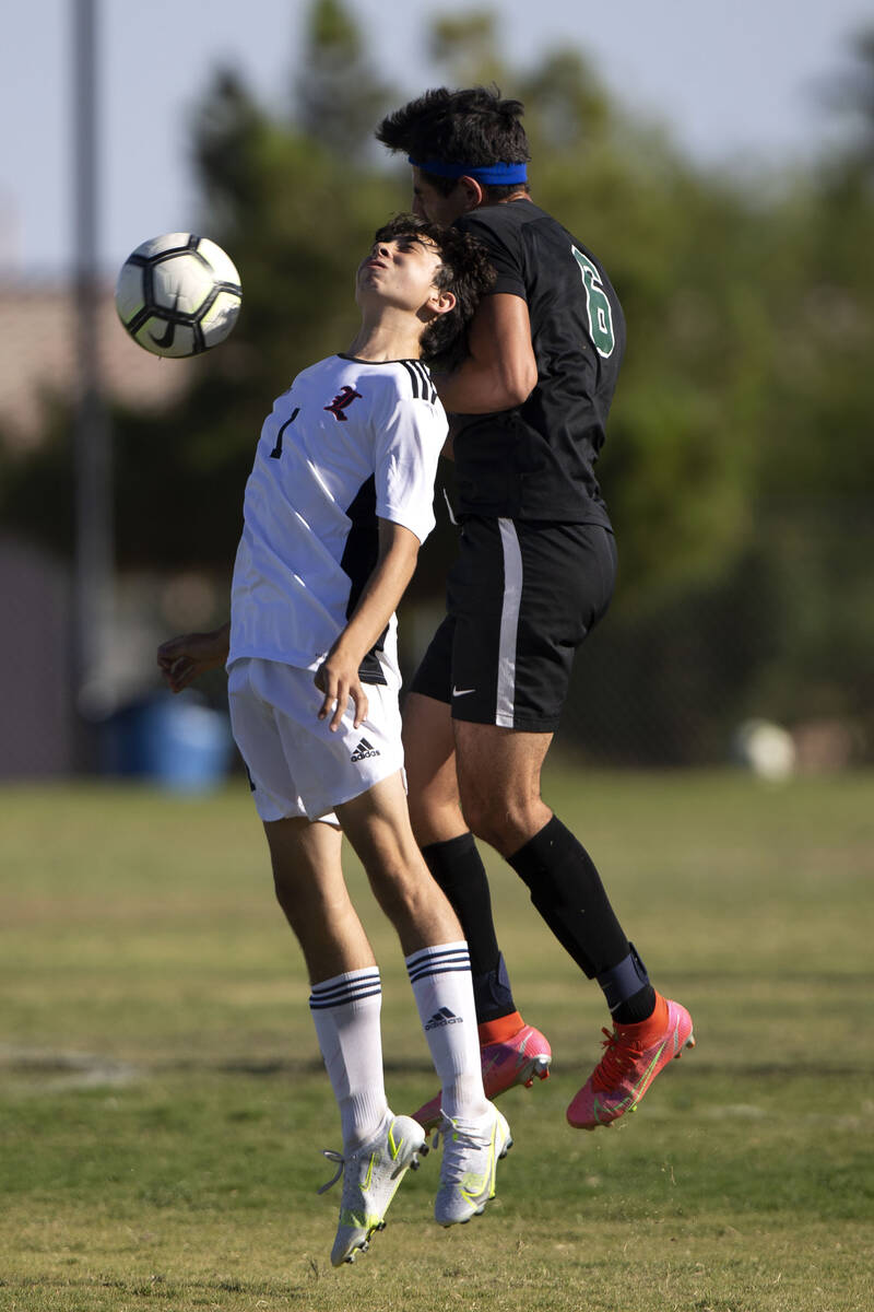 Liberty's Kristopher Cordero (1) and Palo Verde's Ethan Oiknine (9) collide while they go for a ...