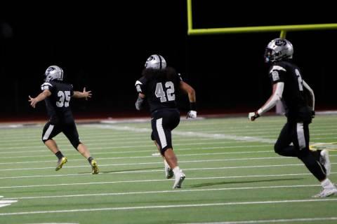Palo Verde High School's Noah Alvares (35) celebrate his winning field goal with Donovan Bell ( ...