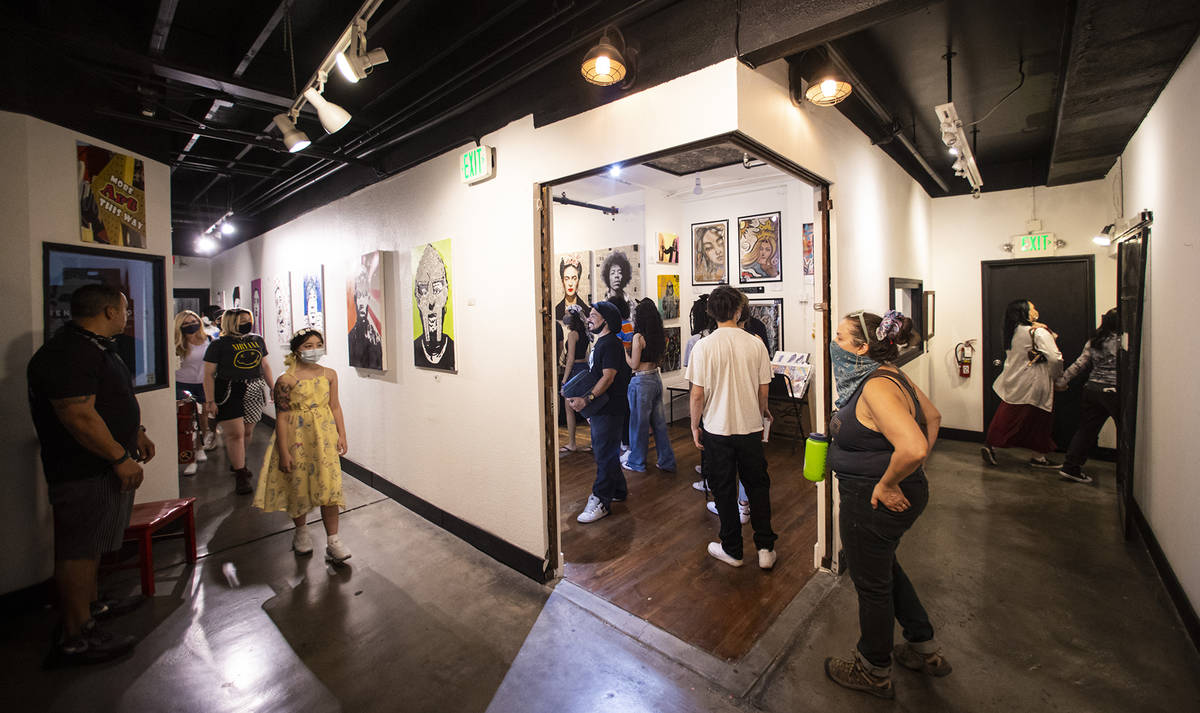 People walk through the Arts Factory during First Friday in the Arts District of downtown Las V ...