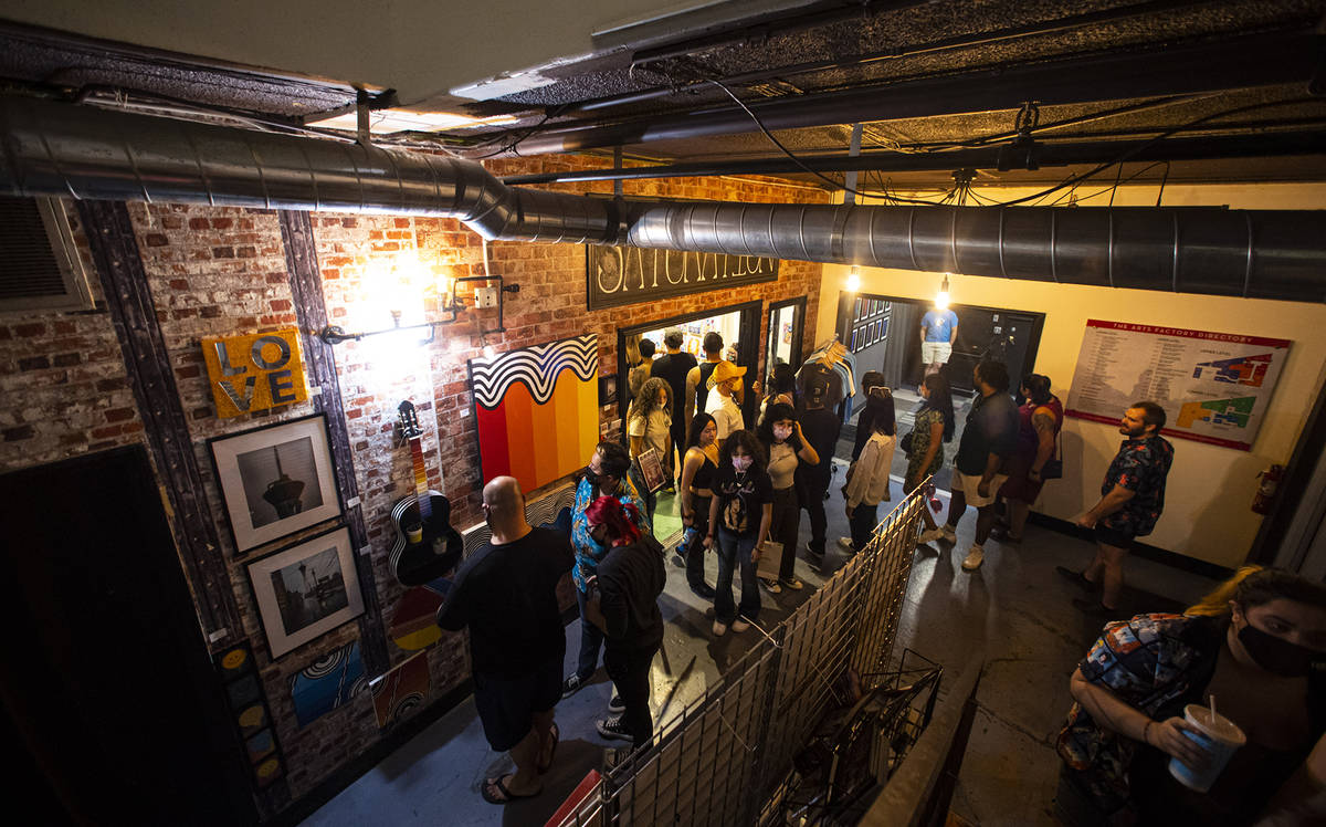 People explore the Arts Factory during First Friday in the Arts District of downtown Las Vegas ...