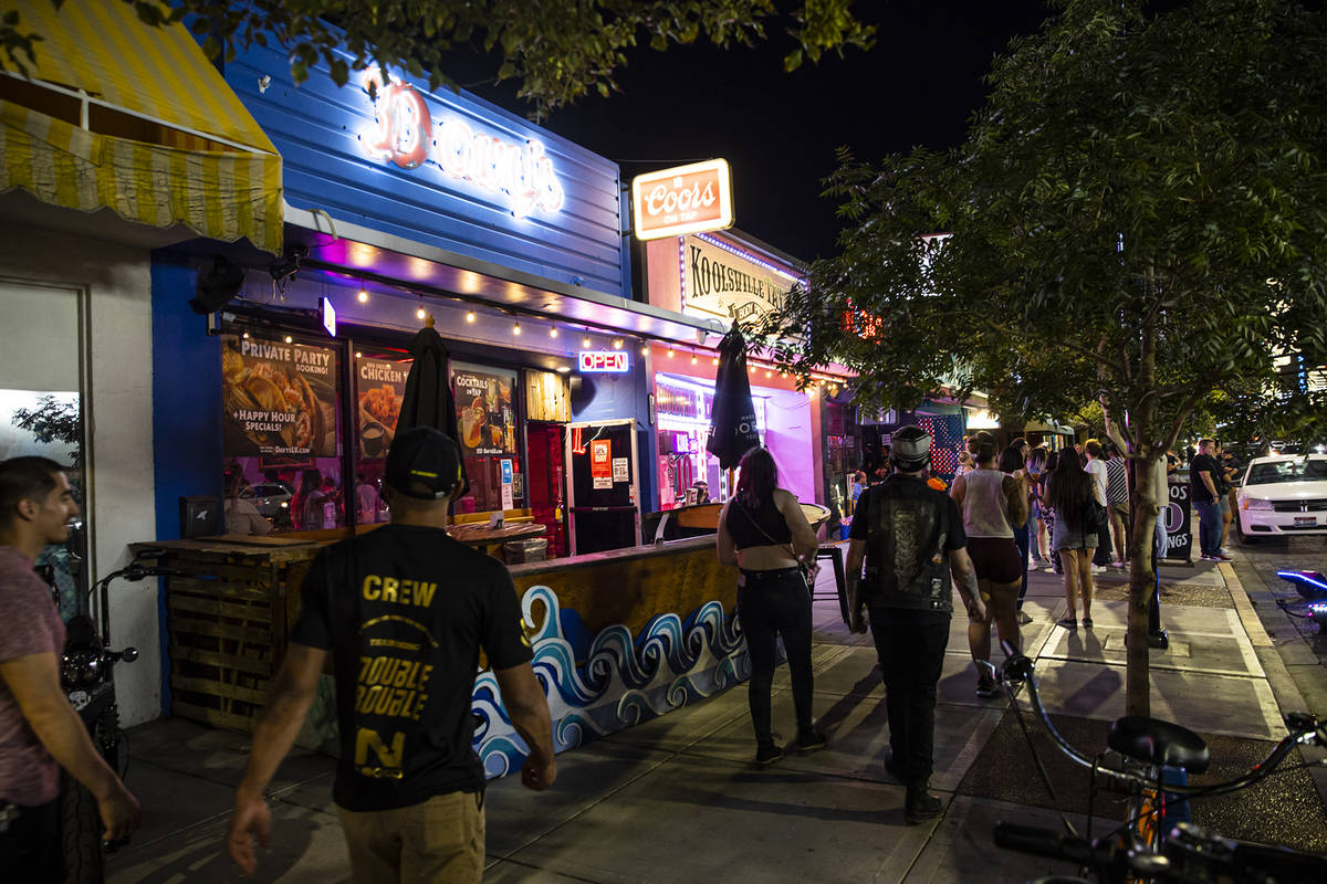 People walk along Main Street during First Friday in the Arts District of downtown Las Vegas on ...