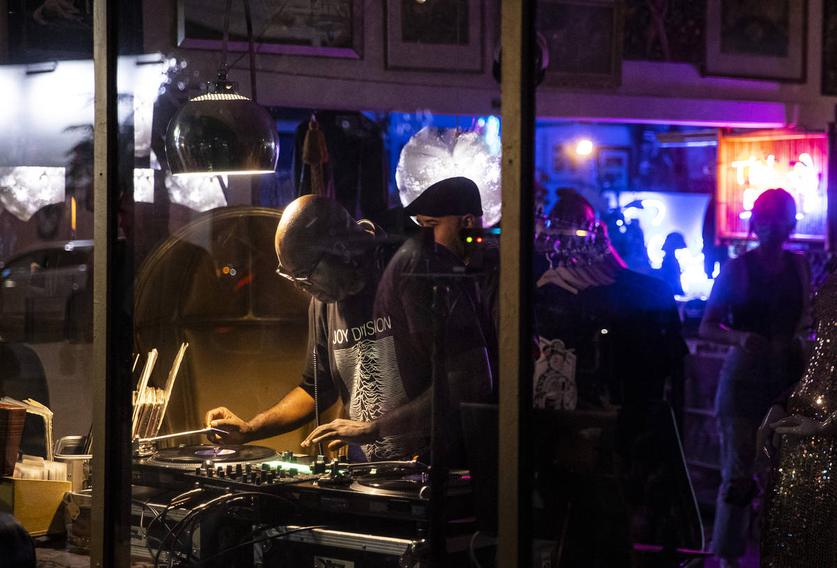 A DJ performs at Vintage Vegas Antiques during First Friday in the Arts District of downtown La ...