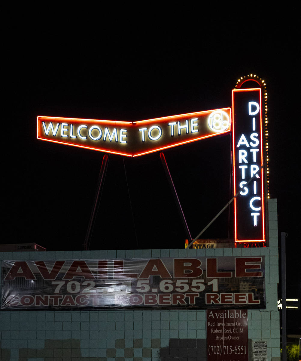 A sign for the Arts District is pictured on Main Street during First Friday in the Arts Distric ...