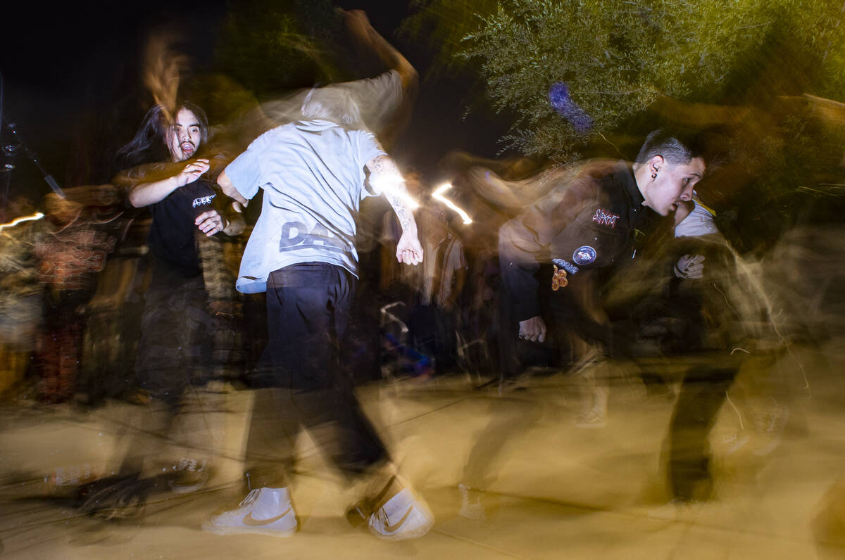 People mosh and dance as Ugly Boy, a band from east Las Vegas, performs during First Friday in ...