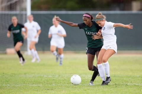 Green Valley's Sage Reed (2) and Foothill's Isabelle Simoneau (16) compete for the ball during ...