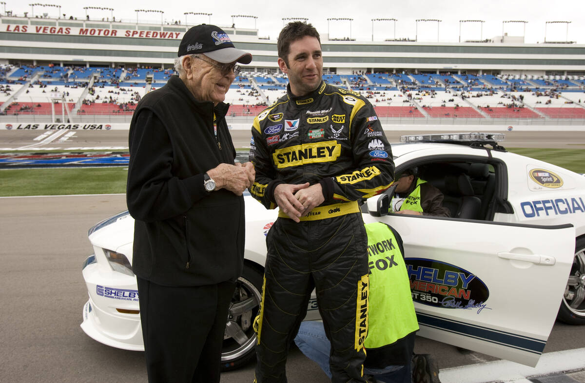 Carroll Shelby, founder of Las Vegas-based Shelby American Inc., poses with Elliott Sadler, a t ...