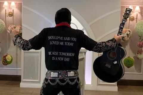 """Elvis tribute artist Brendan Paul shows off the T-shirts given away at the Drake """"Certif ..."""