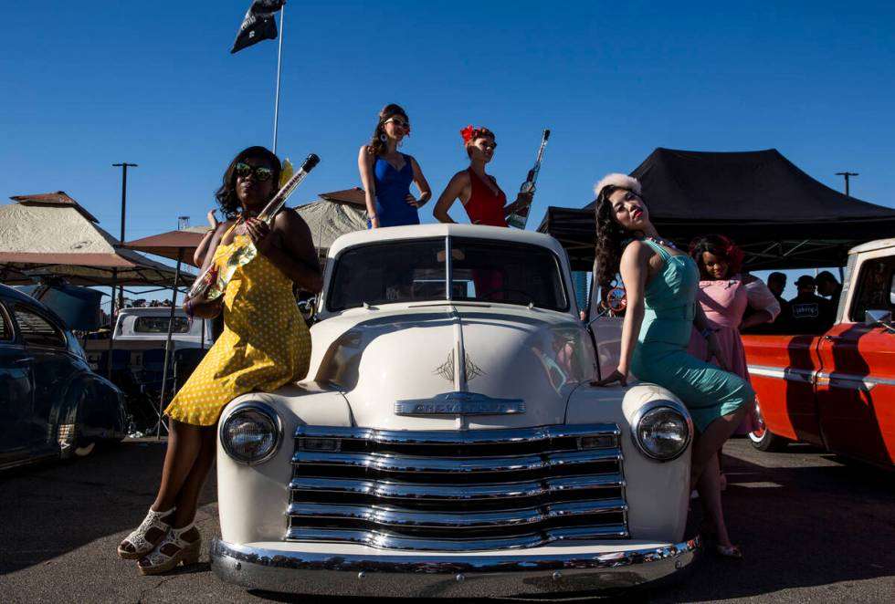 Women dressed in pin up attire, from left, Maria Bryant, Cherri Forever, Roxi Rocket, Sugar Moo ...