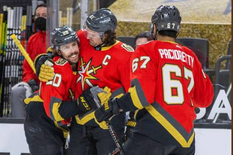 Golden Knights center Chandler Stephenson (20) is congratulated on a score by right wing Mark S ...