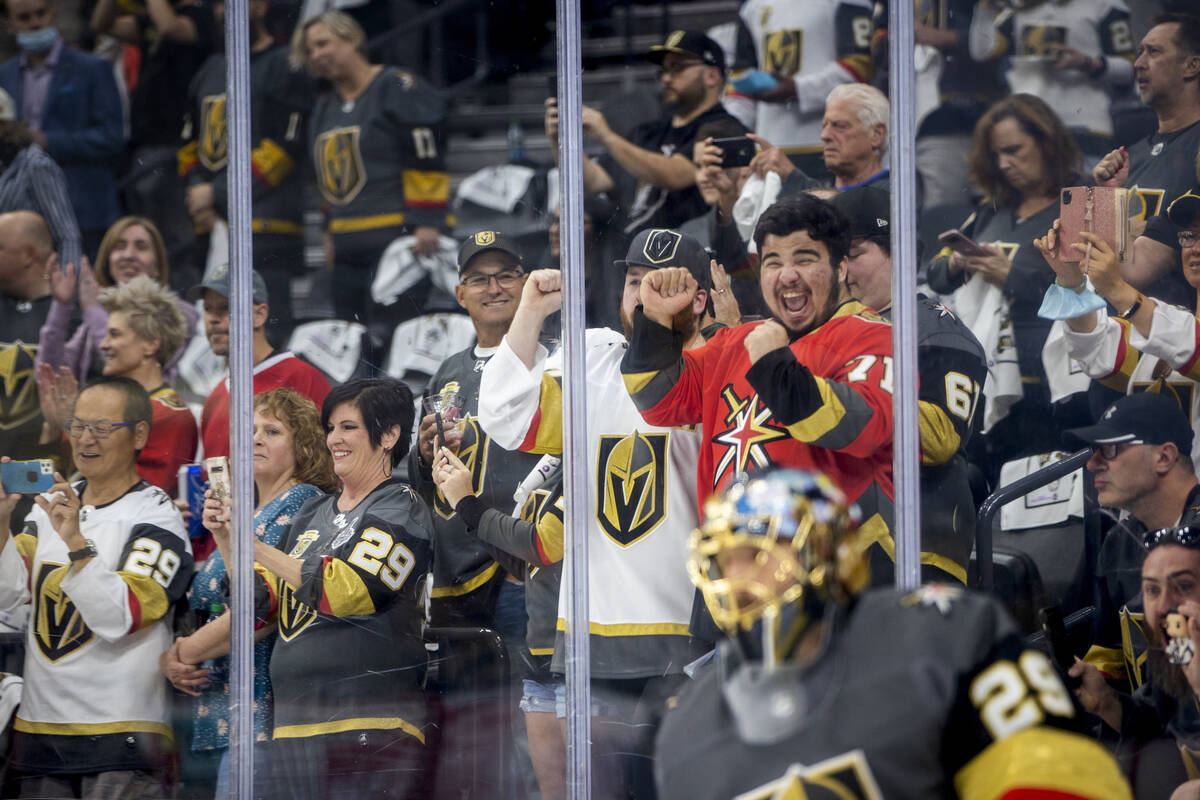 Golden Knights fans get pumped up as goaltender Marc-Andre Fleury (29) and teammates take the i ...