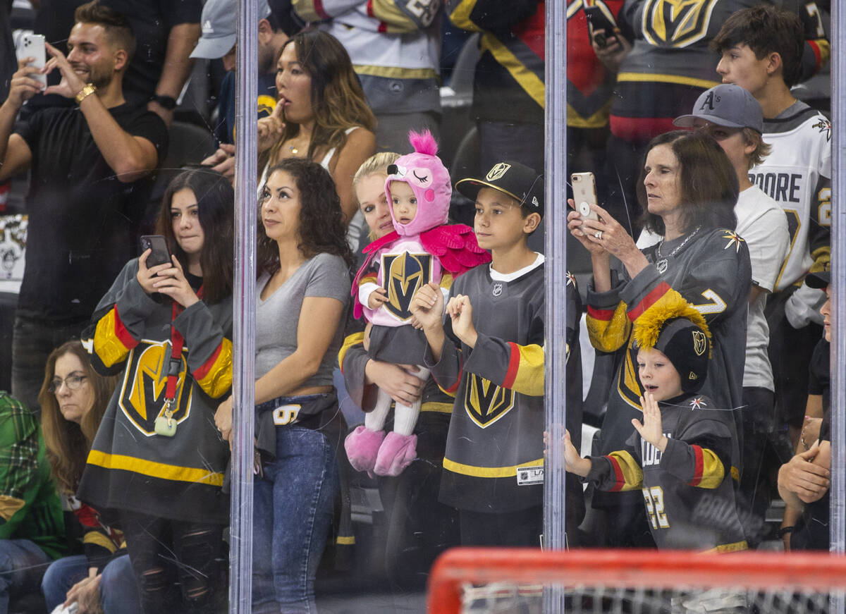 Golden Knights fans get pumped look to the players as they take the ice during warm ups before ...