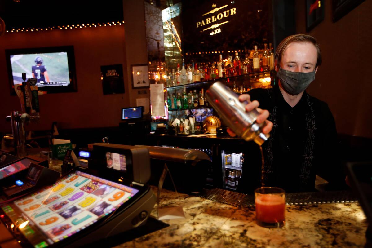 Bartender Alex Siple makes a drink in The Parlour at El Cortez in Las Vegas, Saturday, Sept. 4, ...
