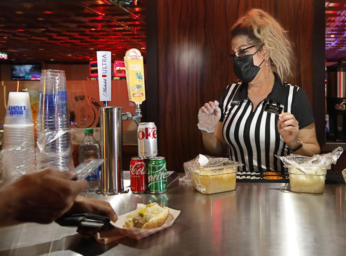 Snack Bar Attendant Loretta Maletto sells a hotdog at El Cortez in Las Vegas, Saturday, Sept. 4 ...