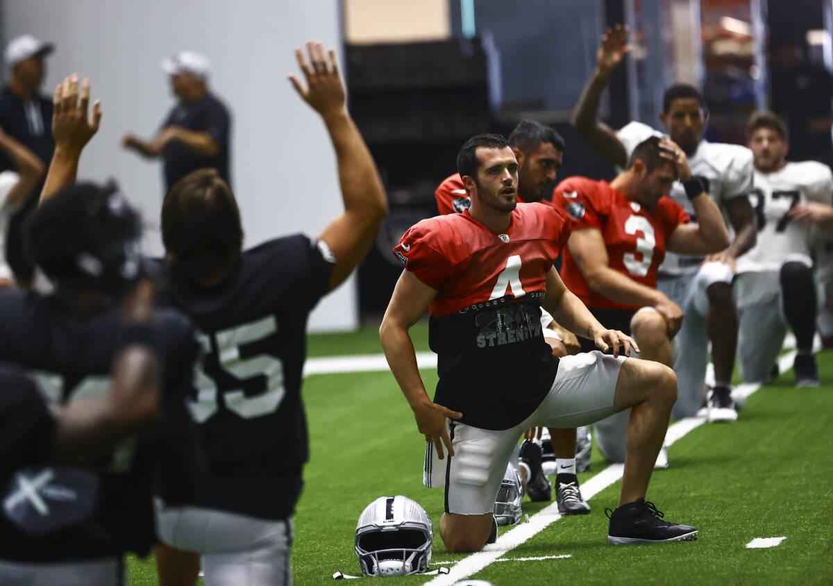 Raiders quarterback Derek Carr stretches during training camp at Raiders Headquarters/Intermoun ...