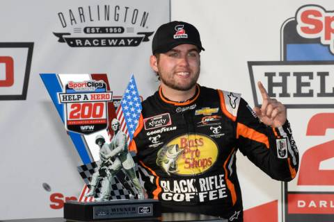 Noah Gragson stands with the trophy after winning a NASCAR Xfinity Series auto race Saturday, S ...