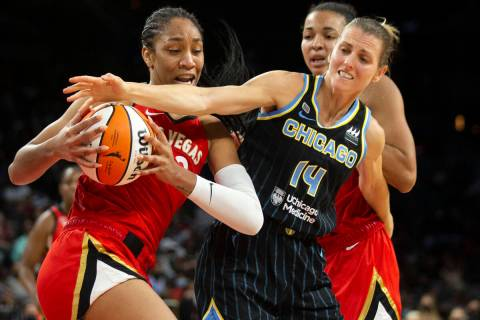 Las Vegas Aces forward A'ja Wilson (22) fights for control of the ball with Chicago Sky guard A ...