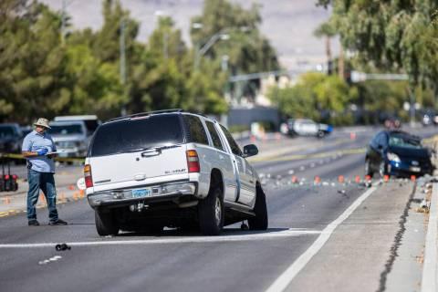 Law enforcement investigates a fatal car crash near North Tenaya Way and Farm Road on Monday, S ...