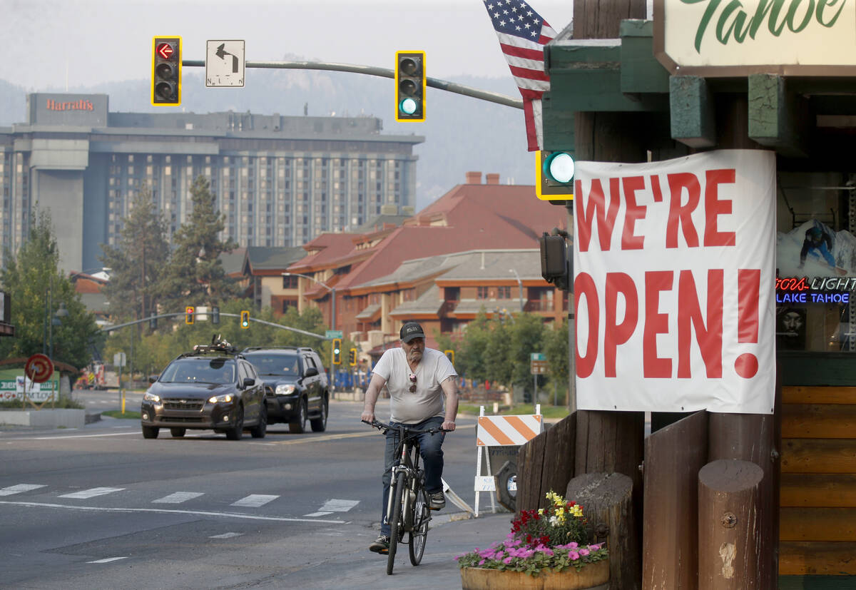 Traffic flows along Highway 50 near Stateline, Nev., as residents begin to return to South Lake ...