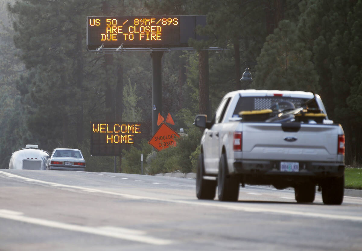 Traffic flows along Highway 50 in South Lake Tahoe, Calif., Sunday, Sept. 5, 2021. Cal Fire off ...