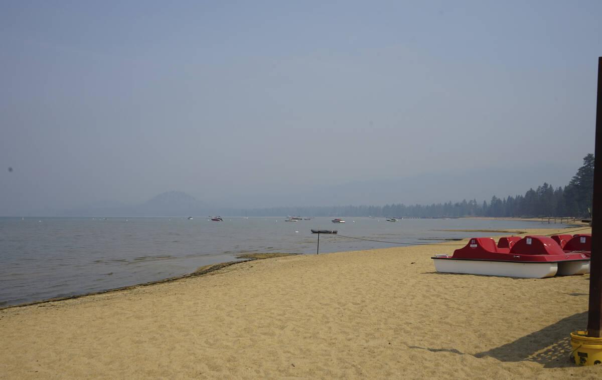 Smoke shrouds parts of Lake Tahoe visible from Ski Run Marina in downtown South Lake Tahoe, Cal ...