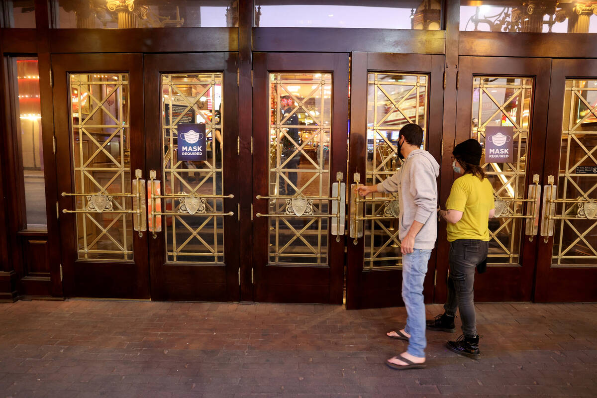 People walk into Main Street Station at the 6 a.m. reopening of the hotel-casino in downtown La ...