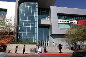 People line up at the UNLV vaccination site Monday, April 5, 2021. Nevada's higher education ...