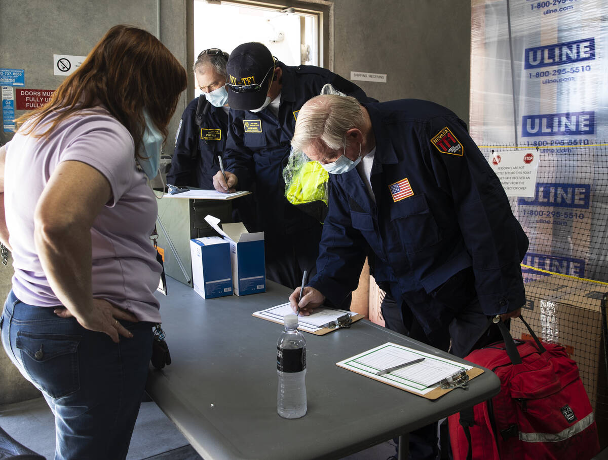 Members of the Nevada Task Force 1 sign in to return their equipments after arriving at Nevada ...