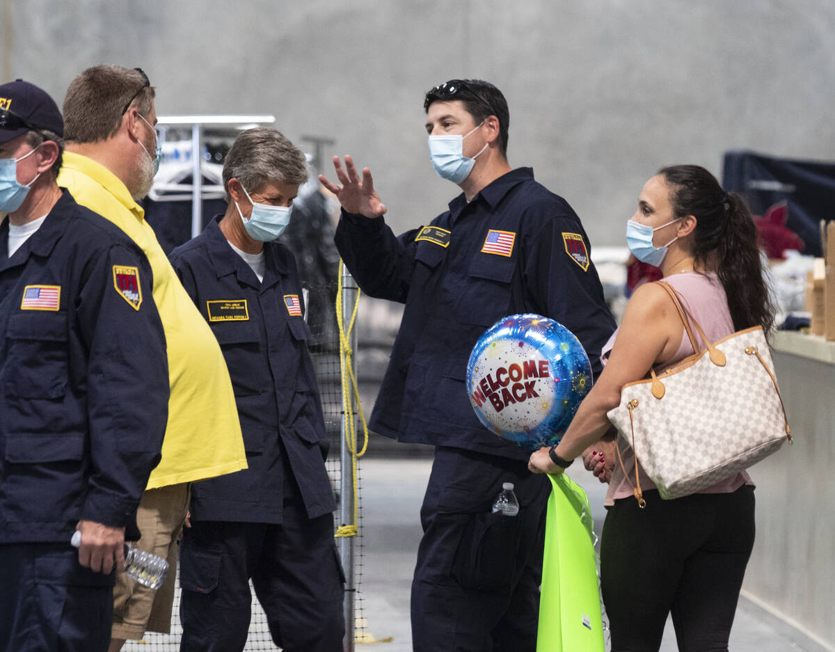 Mathew Gordon waves to fellow firefighters as he leaves the Nevada Task Force 1 Urban Search an ...