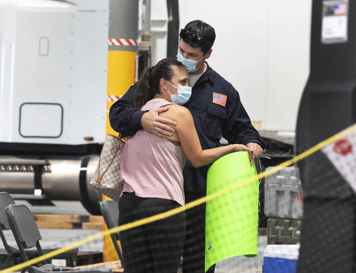 Jessica Gordon welcomes her husband Mathew after he arrived at Nevada Task Force 1 Urban Search ...