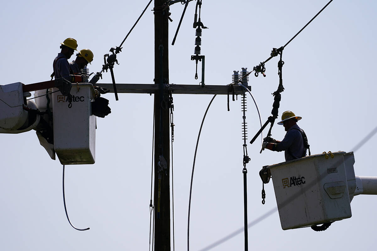 Crews work on power lines that were damaged in the aftermath of Hurricane Ida, Friday, Sept. 3, ...