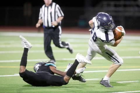 Shadow Ridge High School's Dylan Wood (28) keeps a ball away from Silverado High School's Shyn ...