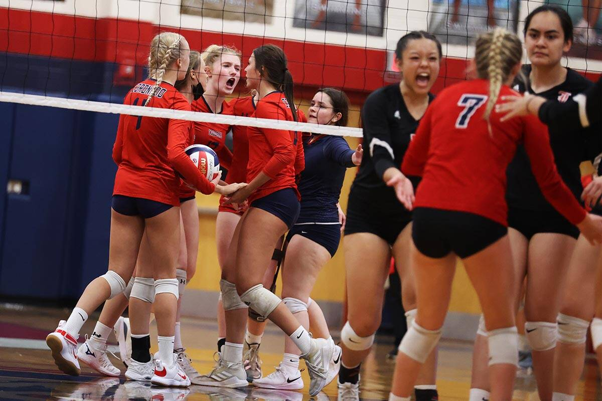 Coronado players react after a play against Liberty in a girls volleyball game at Coronado High ...