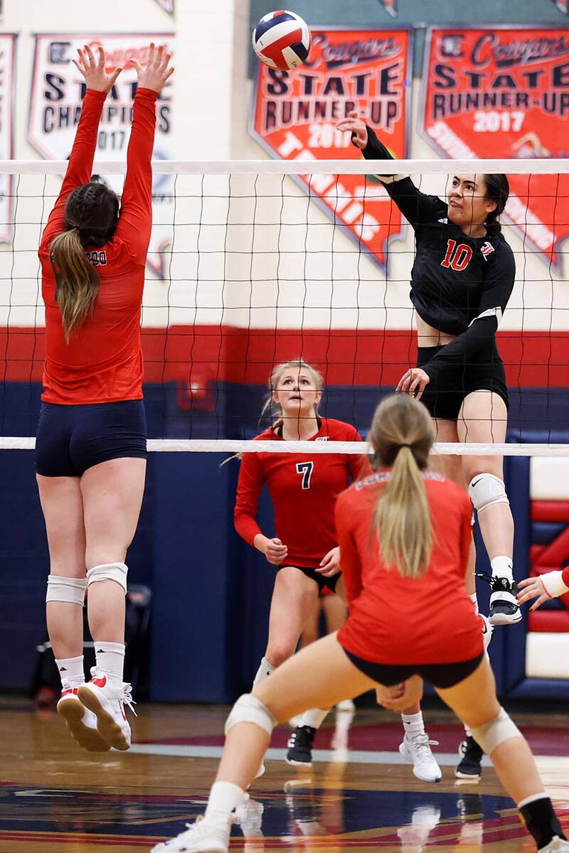 Liberty's Sophia Ortquist (10) spikes the ball against Coronado in a girls volleyball game at C ...