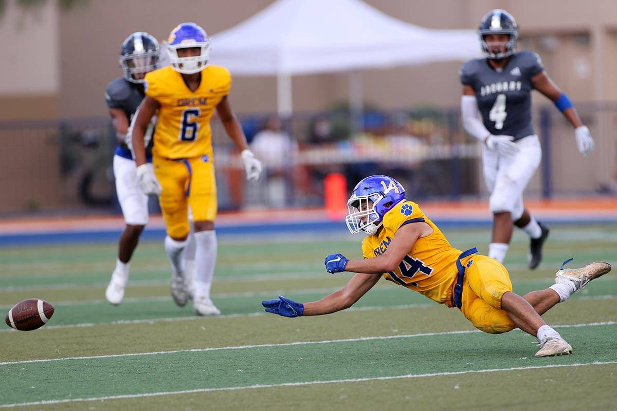 Orem's Kolton Brown (14) dives short of the ball in the second quarter of a football game again ...